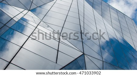 Sky reflection on modern build exterior with glass