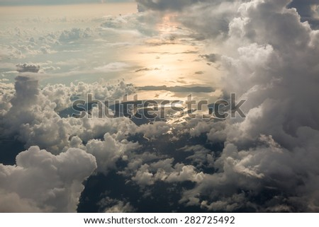 Sky scape cloudscape before sunset.View from window of airplane flying in clouds over Phuket,Thailand   - stock photo