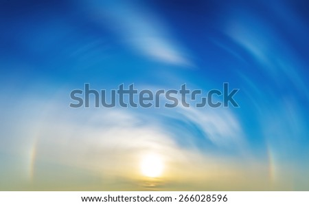 Sky sun halo background blurred clouds - stock photo