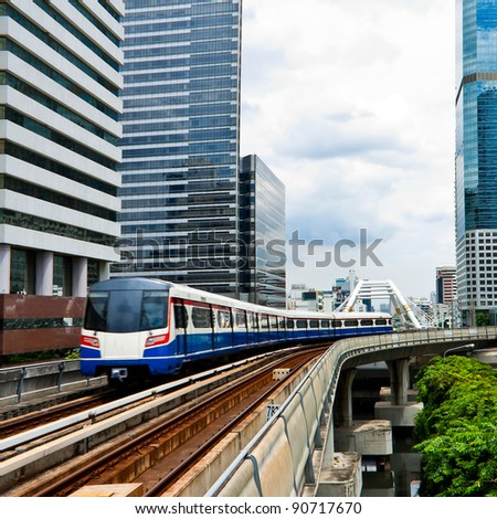 Sky train in Bangkok  with building
