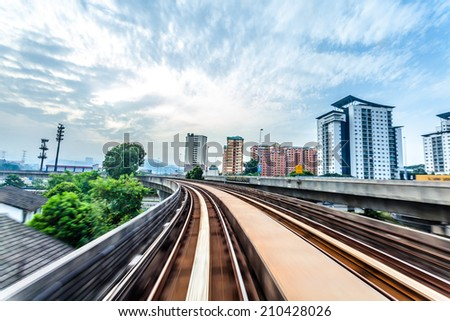 Sky train through the city center in Kuala Lumpur,motion blur - stock photo