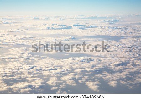 sky view from an airplane above the clouds