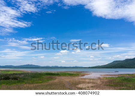 Sky with beautiful cloud above mountain and lake in Thailand