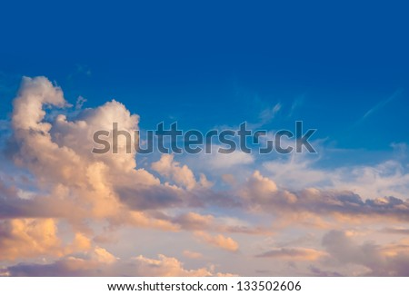 Sky with clouds at sunset after the rainstorm - stock photo