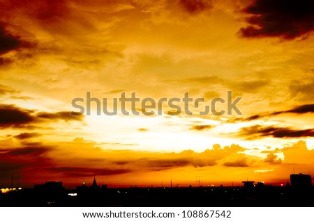sky with clouds over city after sunset in hot shade with silhouette and city light