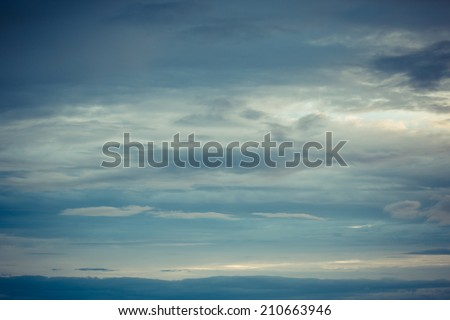 Sky with dramatic clouds in colorful toned - stock photo