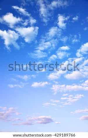 Sky with light cumulus clouds, may be used as background - stock photo