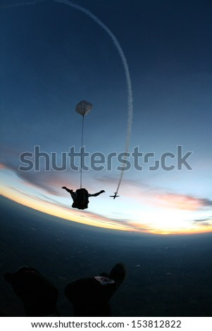 skydive at sunset - stock photo