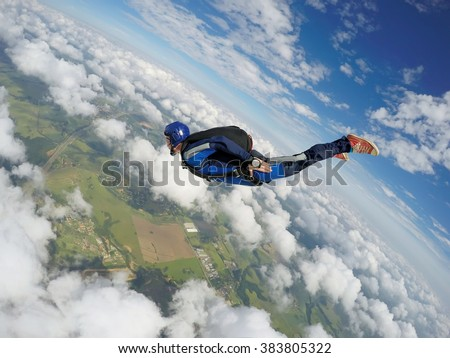 Skydiver dive to the earth. - stock photo