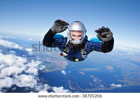 Skydiver falls through the air - stock photo