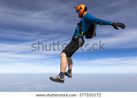 Skydiver performs figure freestyle. - stock photo