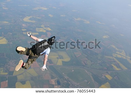 Skydivers falls through the air - stock photo
