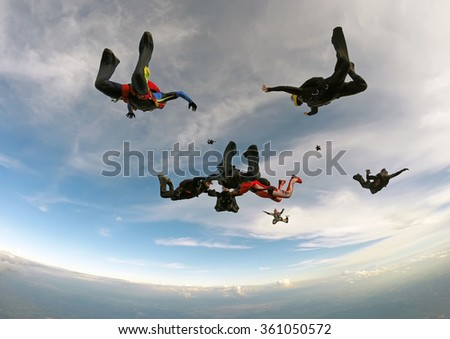 Skydiving formation at the end of the day.