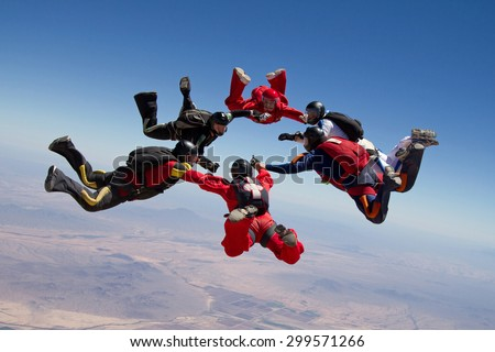 Skydiving group formation - teamwork - stock photo