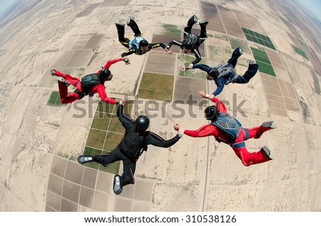 Skydiving group of people team work - stock photo