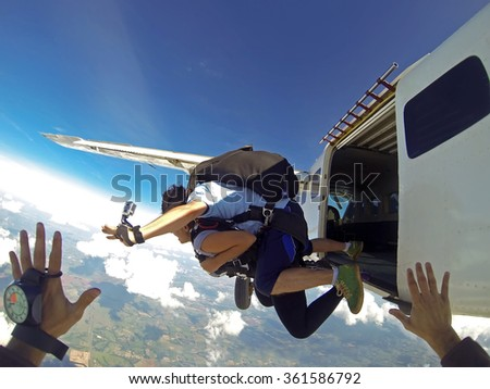 Skydiving jumping from the plane point of view - stock photo