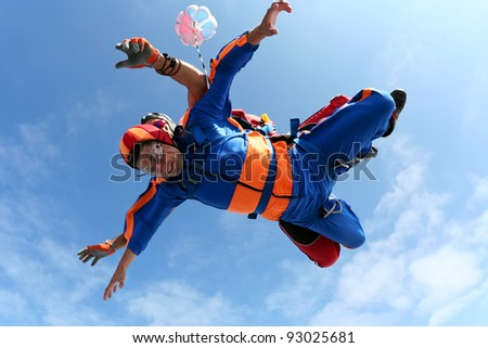 Skydiving photo. Skydiver's eyes are closed. - stock photo
