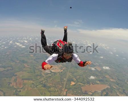 Skydiving smiling man - stock photo