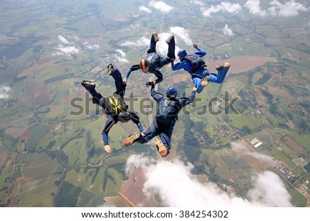 Skydiving team making figures - stock photo