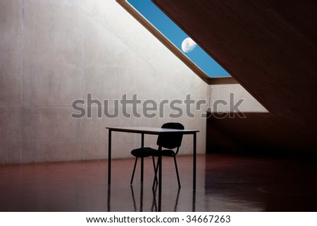 Skylight with moon peering through with table and chair