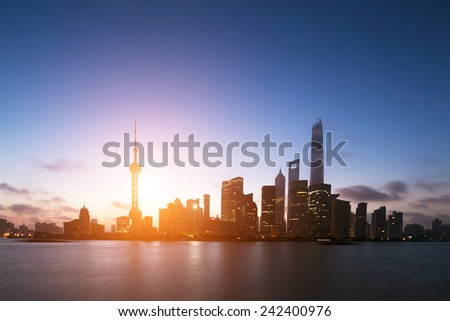 skyline and landscape silhouette of modern city,shanghai.View from riverbank of Huangpu river.