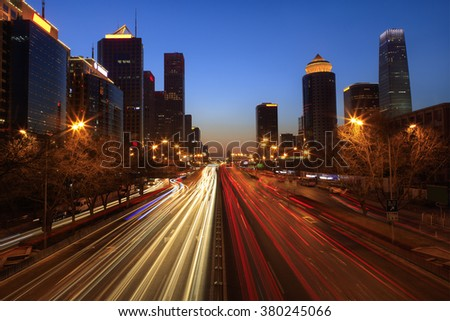 Skyline and traffic in Beijing's Central Business District at dusk. Beijing, China
