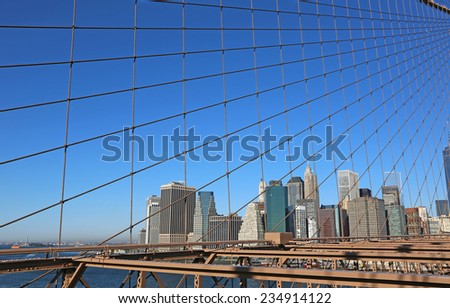 Skyline behind net of cables - New York City - stock photo