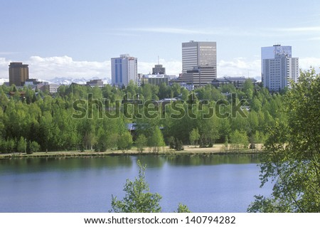 Skyline of Anchorage with Lake Spenard in the foreground and Mt. Hood in the background - stock photo
