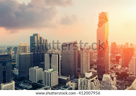 Skyline of big city full of skyscrapers in the business district of Bangkok at night. - stock photo