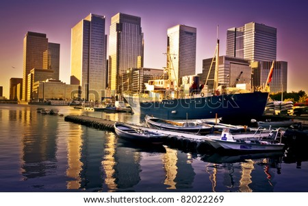 Skyline of Canary Wharf view from West India Millwall Docks. This view includes Citigroup Centre,Morgan Stanley and Luxury Riverside Apartments. - stock photo