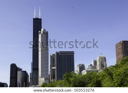 Skyline of Chicago from the river with Willis tower in distance - stock photo