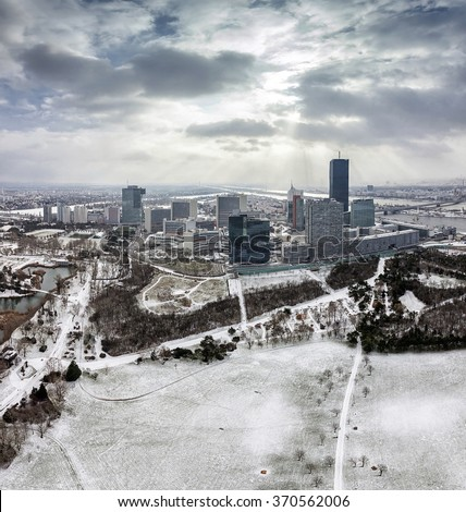 Skyline of Danube City Vienna at the danube river in winter with the new DC-Tower opened February 2014 - stock photo