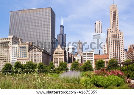 Skyline of Downtown Chicago and a colorful garden by the Millennium Plaza - stock photo