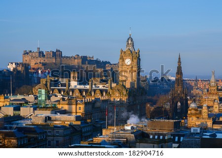 Skyline of Edinburgh at sunrise including the sites Edinburgh Castle, Balmoral Hotel Clock Tower and the Scott monument. - stock photo