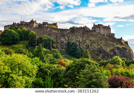 Skyline of Edinburgh castle with beautiful old houses, United Kingdom - stock photo
