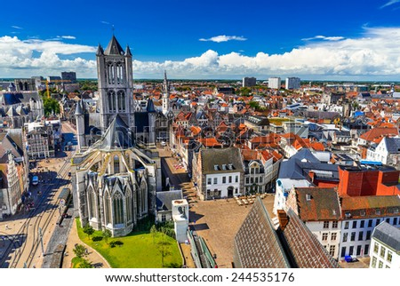 Skyline of Gent, Ghent in West Flanders, Belgium, seen from Belfort tower with St. Nicholas Church. - stock photo