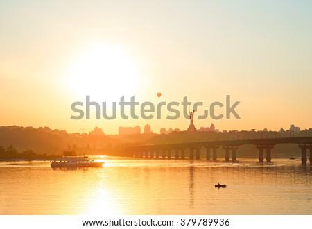 Skyline of Kiev with Mother Motherland monument and Paton bridge at sunset. Ukraine - stock photo