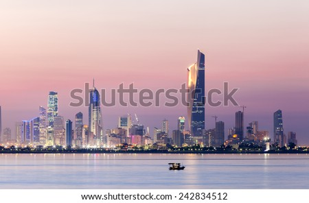 Skyline of Kuwait city at night - stock photo