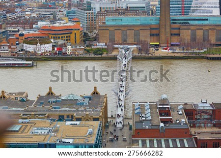 Skyline of London with the Millennium bridge over the Thames, seen from the observation deck of St. Paul's cathedral - stock photo