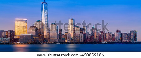 Skyline of lower Manhattan of New York City from Exchange Place at night with World Trade Center. Sized to fit a popular social media cover image placeholder - stock photo