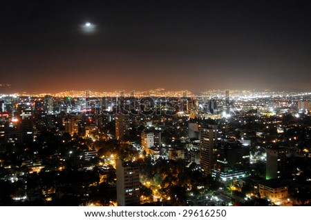 Skyline of Mexico City at night, shot from Colonio Polanco district towards northwest. The sky is unusually clear and free of smog. - stock photo