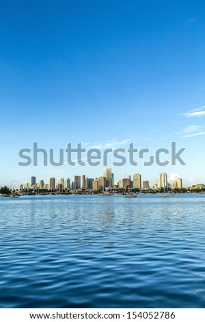 skyline of Miami Florida with  the water of Biscayne Bay. Panoramic skyline of the World famous travel location - stock photo