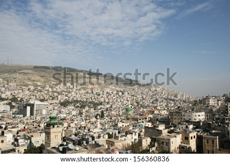 Skyline of Nablus and Israeli militar base on top of the hill, Palestine. West Bank - stock photo