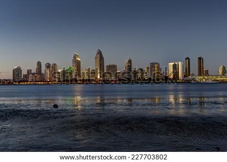 Skyline of San Diego California USA taken at dusk from Centennial Park on  Coronado Island. - stock photo