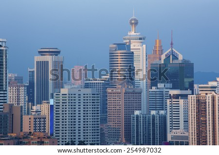 Skyline of Shenzhen City, China. Viewed from Hong Kong border  - stock photo