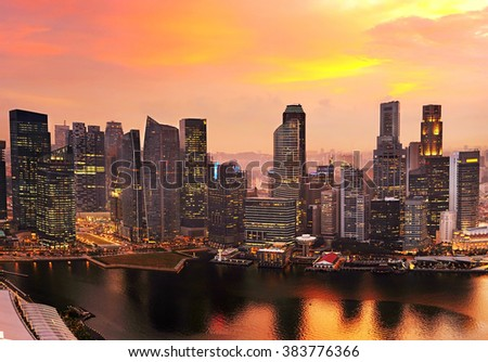 Skyline of Singapore Downtown Core colorful sunset sky - stock photo