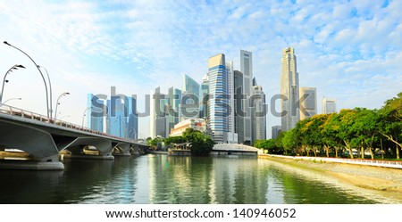 Skyline of Singapore downtown with reflection in the river - stock photo