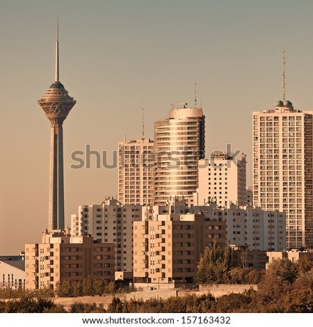 Skyline of Tehran in the orange warm glow of sunset. - stock photo