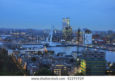 skyline of the city of rotterdam by night - stock photo