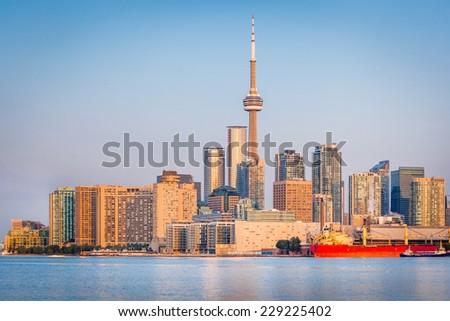 Skyline of Toronto over Ontario Lake at sunrise - stock photo